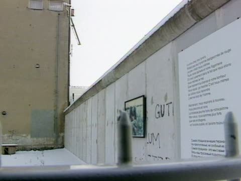 long concrete wall w/ writing on plaque attached to the wall pan to single guard tower - drittes reich stock-videos und b-roll-filmmaterial