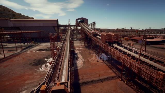 long conveyor belts at an iron ore mine - eisenerz stock-videos und b-roll-filmmaterial
