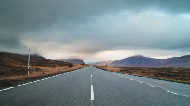 long country road in the scottish highlands - tranquil scene stock videos & royalty-free footage