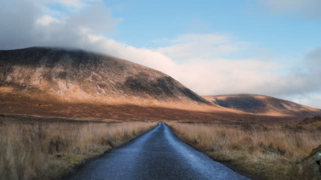 long country road in the scottish highlands - country road stock videos & royalty-free footage
