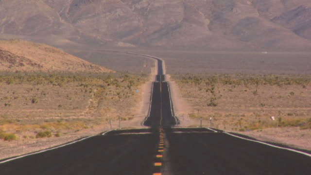long desert road - wide shot stock videos & royalty-free footage