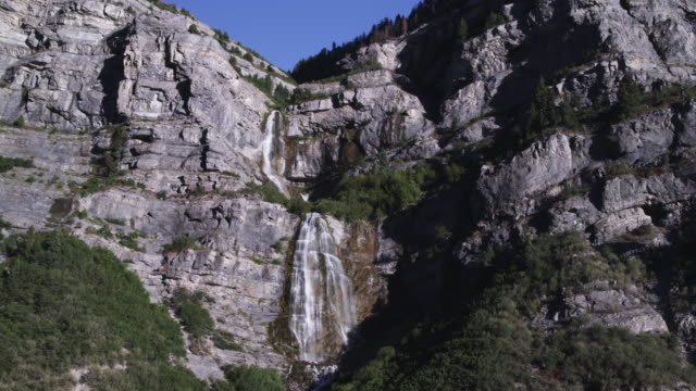 long distance static shot of bridal veil falls in provo canyon. - provo stock-videos und b-roll-filmmaterial