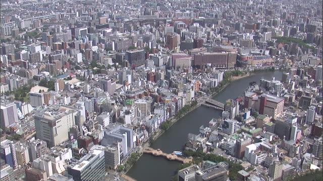 vídeos de stock, filmes e b-roll de long docks stretch into the ocean from the coast of okinawa prefecture. - prefeitura de fukuoka