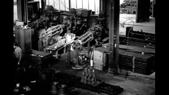 long dolly shot of factory floor men working long dolly shot of factory floor on january 01 1930 - manufacturing occupation stock videos & royalty-free footage