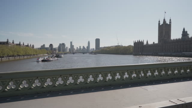 a long dolly shot over westminster bridge, london looking towards  the houses of parliament - street stock videos & royalty-free footage