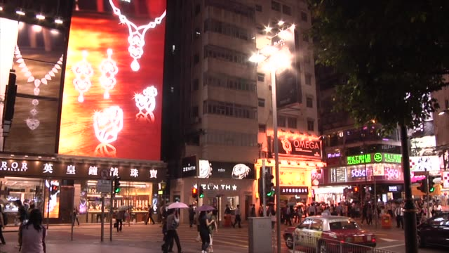 long duration shot times square in city centre at night, people walking, bright signs, digital advertising billboards and screens times square in... - times square causeway bay stock videos & royalty-free footage