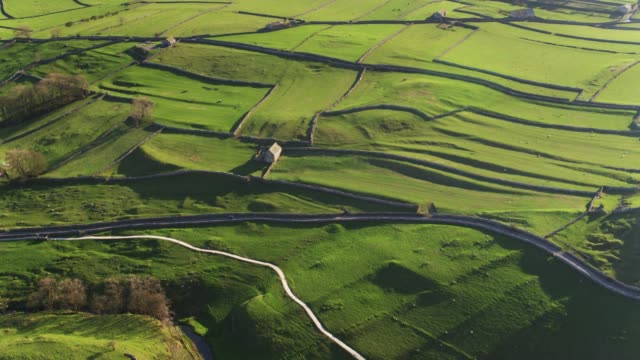 long evening shadows on pastoral yorkshire landscape - drone shot - patchwork landscape stock videos and b-roll footage