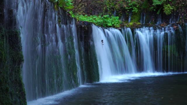 4k long exposure: karuizawa shiraito waterfalls in nagano, japan. - nagano prefecture stock videos & royalty-free footage