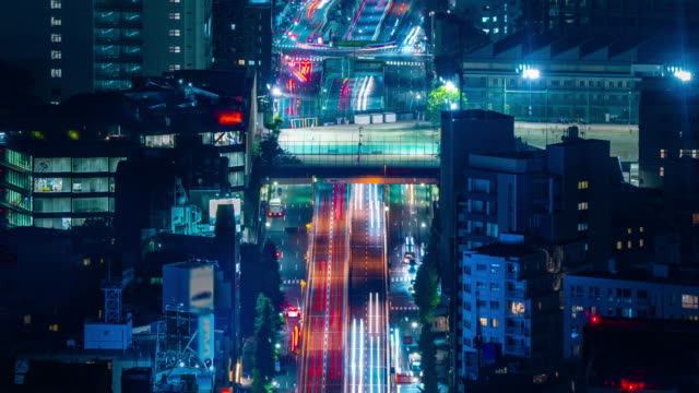 4k long exposure night traffic timelapse taken from roppongi hills mori tower, tokyo, japan - elevated road stock videos & royalty-free footage