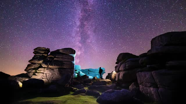 long exposure of a figure stargazing under the milky way, in a rocky dartmoor landscape, with light painting and parallax displacement, on september... - solitude stock videos & royalty-free footage