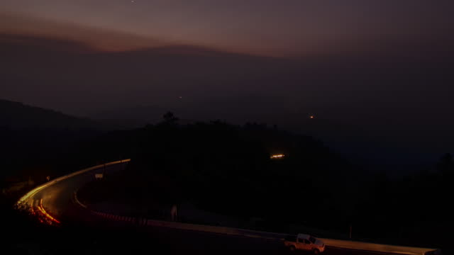 Long Exposure of road at night time on the mountain , Time-lapse movement , 4k(UHD)