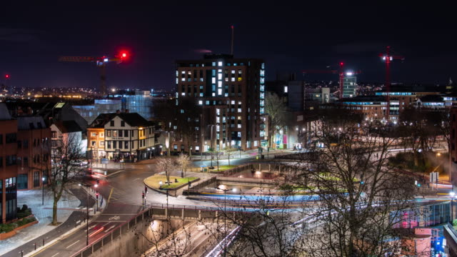 a long exposure time lapse of cars weaving light trails through the streets of broadmead near cabot circus in bristol city center uk - light trail stock videos & royalty-free footage