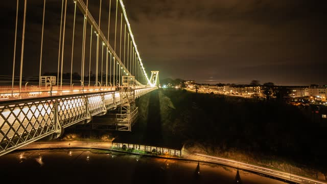 long exposure time lapse of clifton suspension bridge illuminated at night as traffic passes below leaving light trails on april 19, 2021 in bristol,... - blurred motion stock videos & royalty-free footage