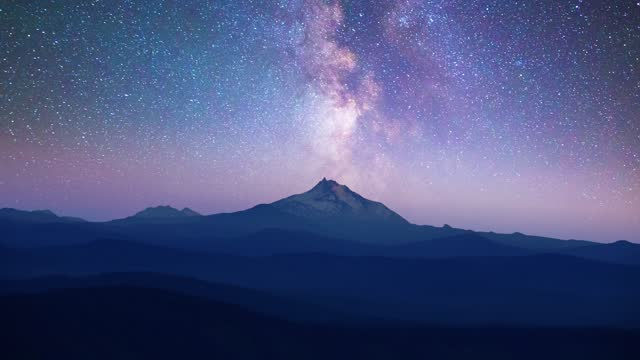 long exposure time lapse of the milky way over a snowcapped mountain peak on july 02 in mount jefferson, oregon. - snowcapped mountain stock videos & royalty-free footage