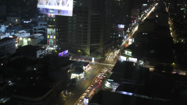 phnom penh, cambodia- february 24, 2017 : long exposure timelapse of intersection from high rise building at night -phnom penh ,cambodia - cambodia stock videos and b-roll footage