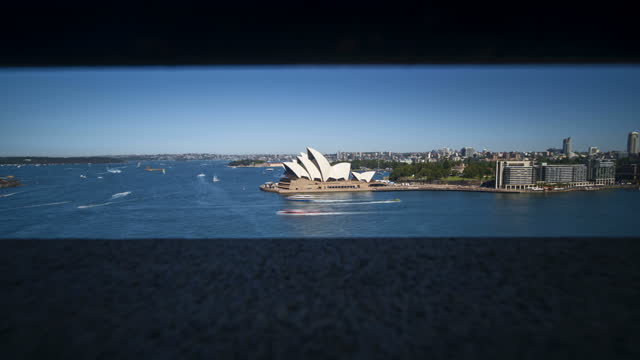 4k long exposure timelapse though the hole from the bridge with opera house background, sydney, australia - bridge built structure stock videos & royalty-free footage