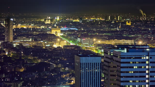 long focal night shot over paris from elevated view. many public buildings visible : arc de triomphe, louvre, grand palais, notre dame, great library, panthã©on. - arch stock videos & royalty-free footage