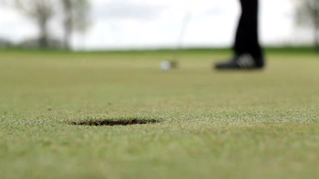 long golf putt into hole - putting stock videos & royalty-free footage