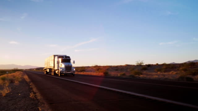 long haul semi truck on a rural western usa interstate highway - trailer stock videos & royalty-free footage