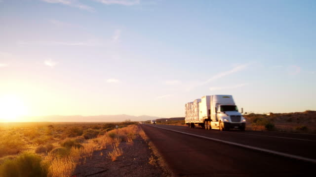 long haul semi truck on a rural western usa interstate highway - heavy goods vehicle stock videos & royalty-free footage