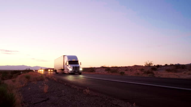 long haul semi truck on a rural western usa interstate highway - haulage stock videos & royalty-free footage