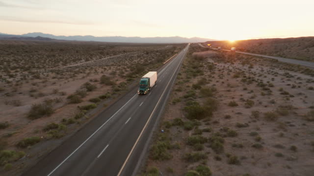 long haul semi truck on a rural western usa interstate highway - convoy stock videos & royalty-free footage