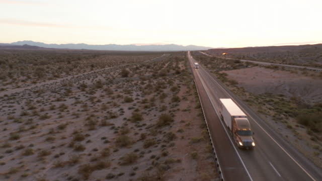 long haul semi truck on a rural western usa interstate highway - articulated lorry stock videos & royalty-free footage