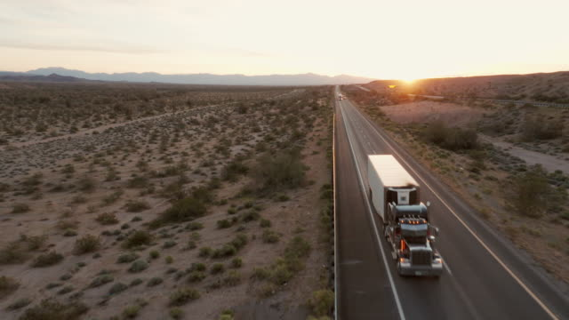 long haul semi truck on a rural western usa interstate highway - american interstate stock videos & royalty-free footage