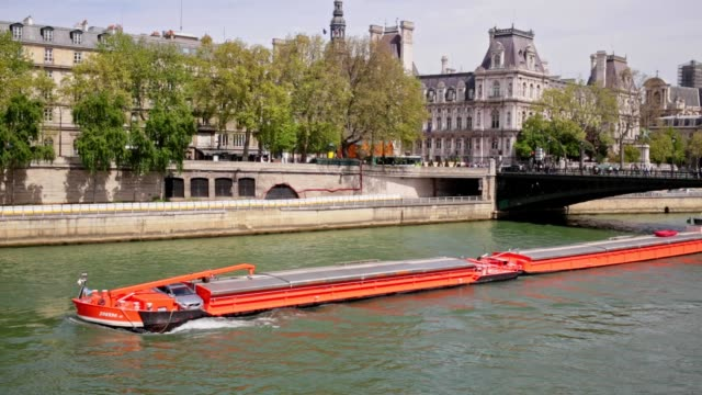 Long Industrial Barge Boat on the River Seine in Paris France