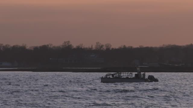 vídeos y material grabado en eventos de stock de long island sound boat on mooring in late sun. - vector