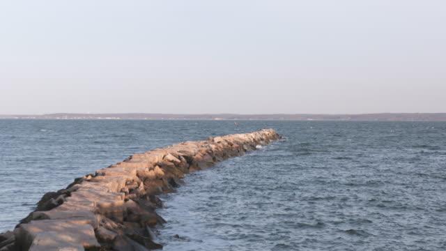 vídeos y material grabado en eventos de stock de long island sound breakwater 2 - vector