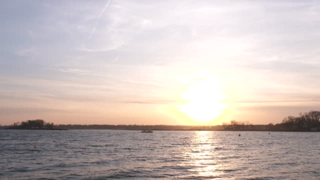 vídeos y material grabado en eventos de stock de long island sound sunset pan hen island - vector