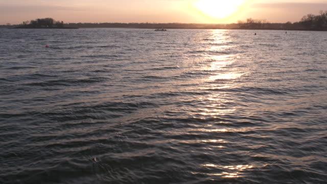 vídeos y material grabado en eventos de stock de long island sound sunset waves tilt - vector