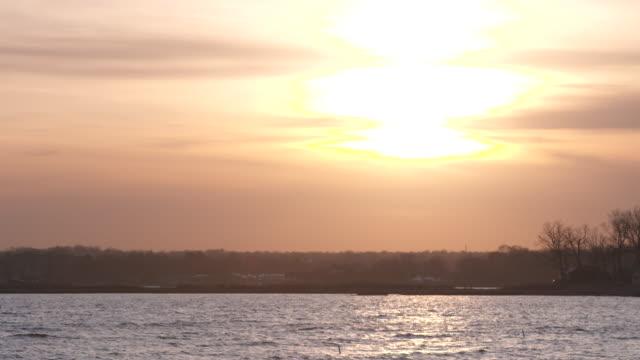 vídeos y material grabado en eventos de stock de long island sunset 2 - vector