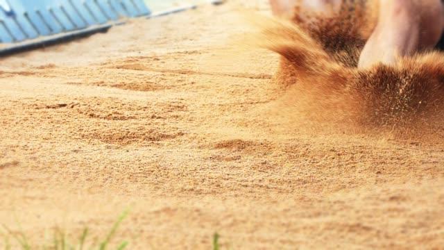 long jumper landing in sand - athlete stock videos & royalty-free footage