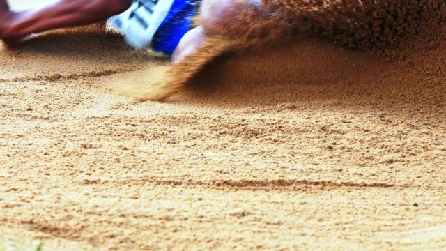 long jumper landing in sand - long jump stock videos & royalty-free footage