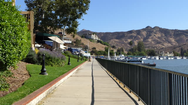 long lakeside walk by restaurants on the left slow zoom out westlake village a small southern california city in los angeles county originally a... - westlake village california stock videos & royalty-free footage