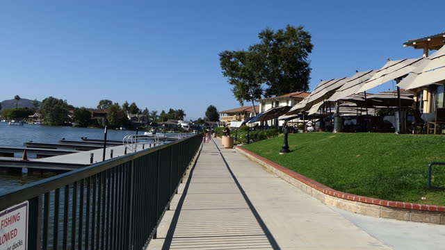 long lakeside walk by restaurants on the right the lake and docks on the left westlake village a small southern california city in los angeles county... - westlake village california stock videos & royalty-free footage