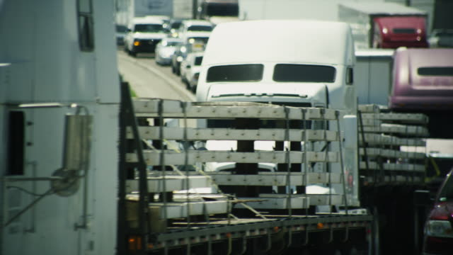 Long lens, huge traffic congestion on interstate highway.