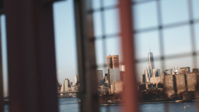 long lens shot looking through a fence at the new york city skyline - east river stock videos & royalty-free footage