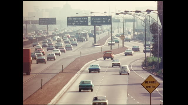 long lens shot of 1970s rush hour traffic on freeways looking east towards downtown los angeles - city of los angeles stock videos & royalty-free footage