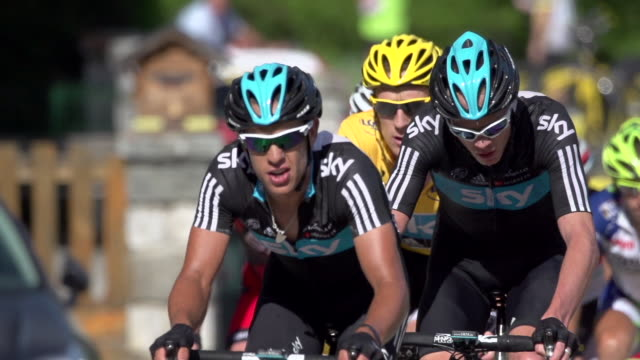 long lens shot of richie porte chris froome leading bradley wiggins followed by cadel evans on a climb in stage 11 of the 2012 tour de france - lens pas de calais stock videos & royalty-free footage