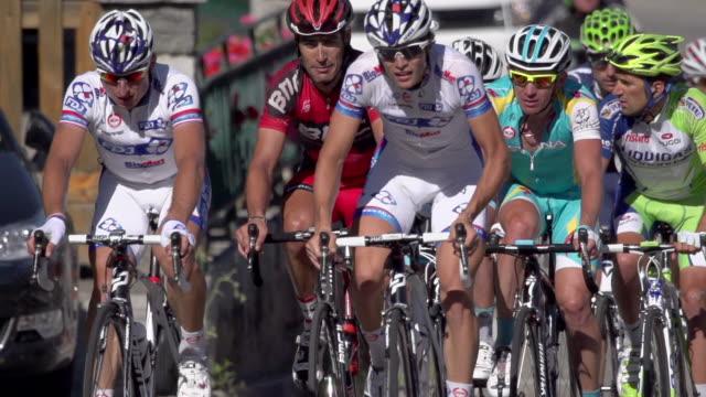 long lens shot of riders climbing on stage 11 of the 2012 tour de france - lens pas de calais stock videos & royalty-free footage