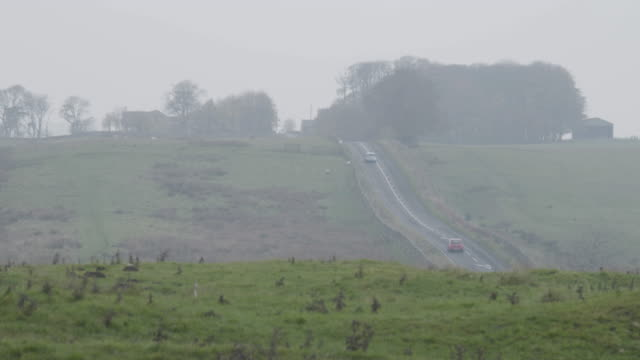 long lens shot of the road b6318 - uphill stock videos & royalty-free footage