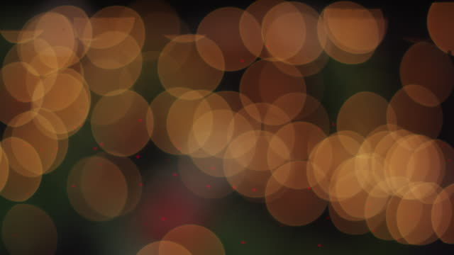 long lens, soft-focus shot of christmas lights creating a beautiful background plate. - soft focus stock videos & royalty-free footage