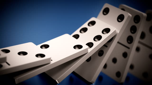 long line of dominoes falling. loopable cg anmation. - dominoes stock videos & royalty-free footage