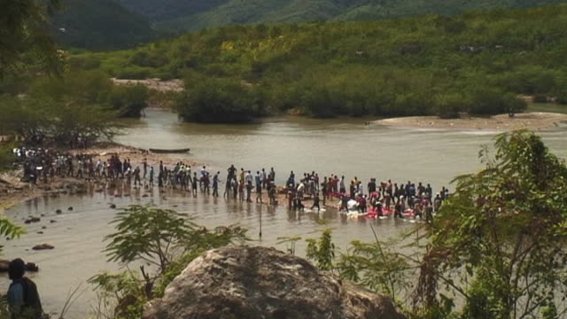 Long line of Haitians distribute food aid and supplies following devastating earthquake Haiti 11 March 2010