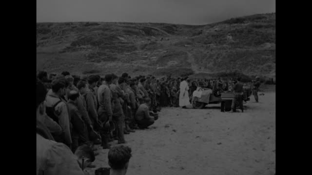 long line of men facing right with sandhill beyond; chaplain reading with quick pan to makeshift altar; african-american men with heads bowed /... - civilian stock videos & royalty-free footage