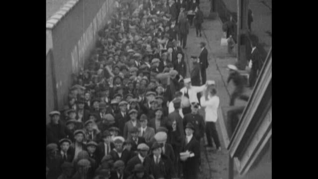 long line of people at 8th avenue side of the polo grounds, some waving as they wait to buy tickets to the world series between the ny giants and the... - ニューヨーク・ヤンキース点の映像素材/bロール