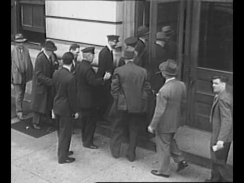 long line of people waiting to obtain gasoline rationing cards in new york city during world war ii / police officer guides two lines of people into... - hand of cards stock videos & royalty-free footage